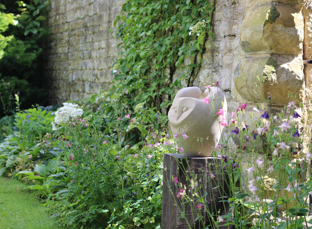 Owl Fly sculpture carved in Bath Stone