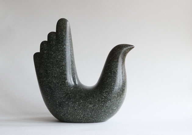 Tall tailed bird sculpture