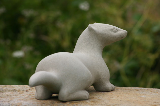 Stoat sculpture carved in stone