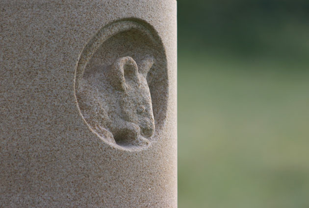 Mouse in a hole relief carved in stone