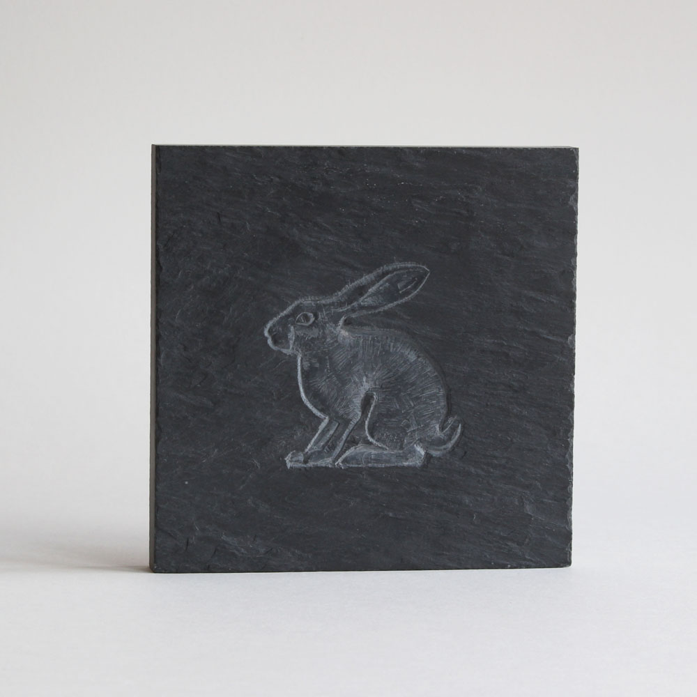 Hare carved on a slate tile