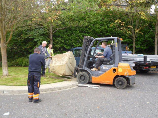 stone block being put in position