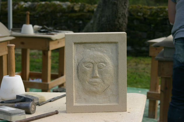 face stone carving