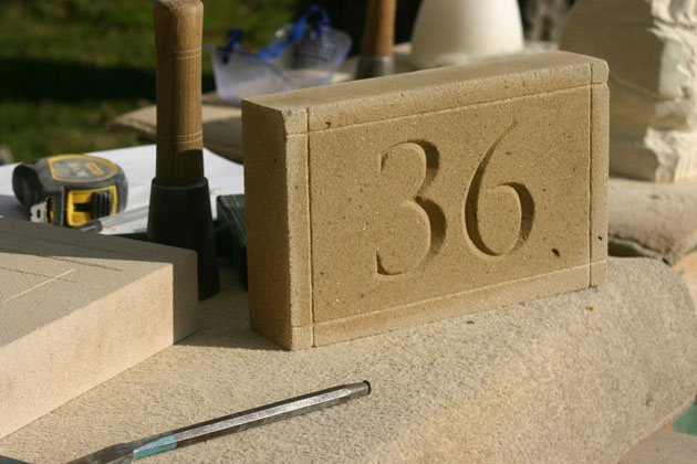 stone carved letters