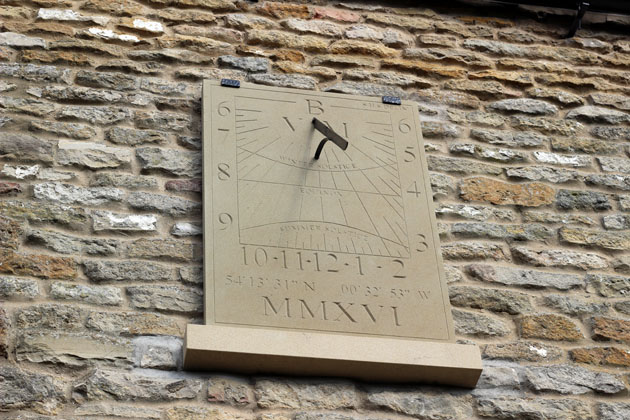 Wall Dial carved stone sundial