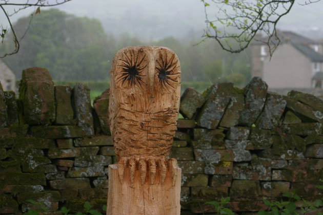 Owl sculpture carved in wood