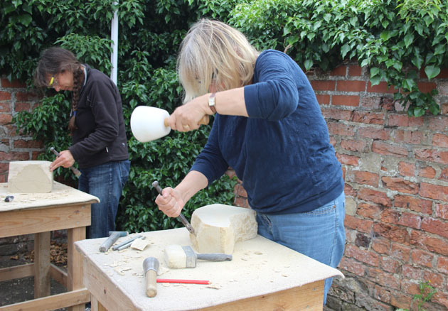First time stone carvers at Rural Arts Workshop