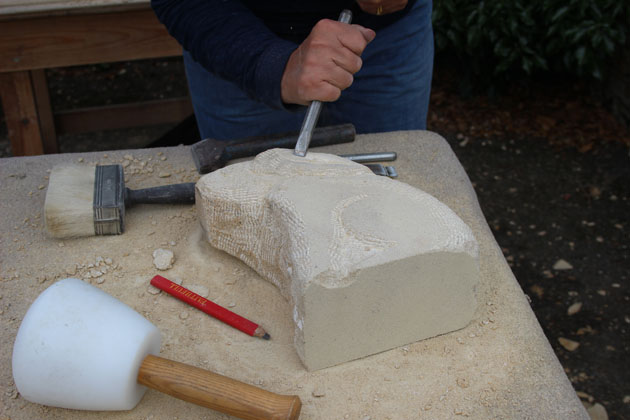 Hare has his ears shaped at Rural Arts stone carving workshop
