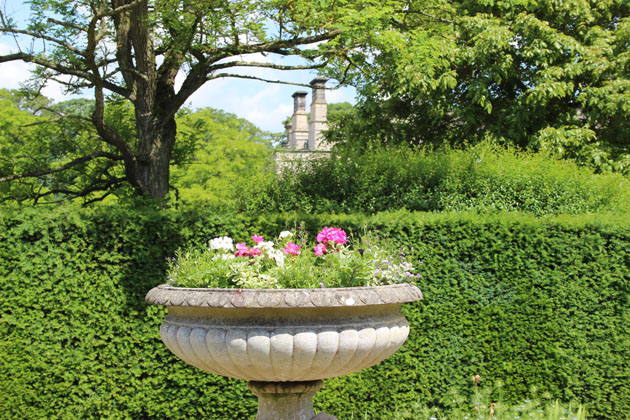 Planted urn in the garden at Nunnington Hall