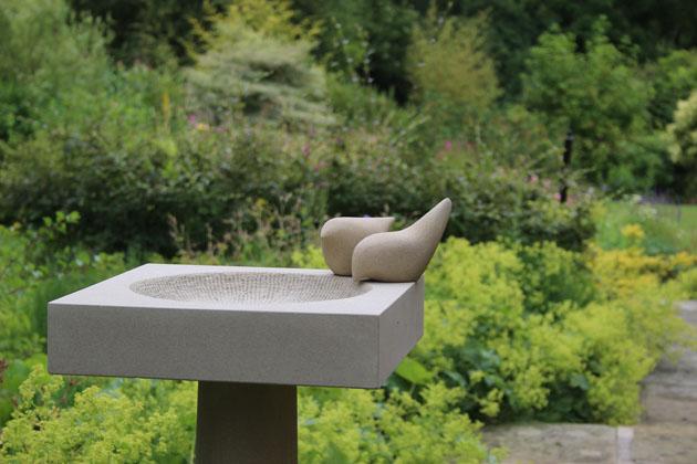 Tall and elegant stone birdbath