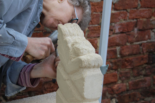 Uncurling leaves and twisting shapes chiseled at Rural Arts stone carving workshop