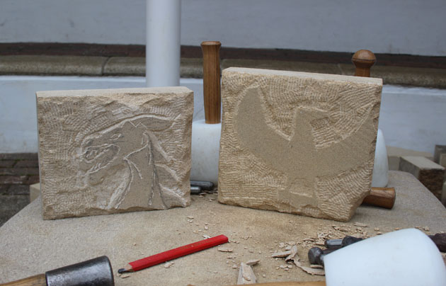 Stone carving of a dragon and a bird