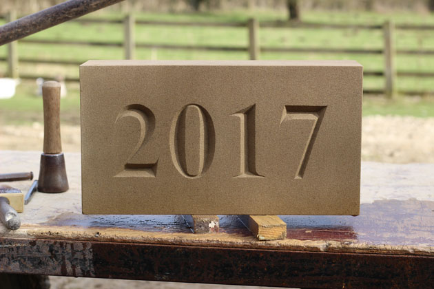 Incised lettering date stone 2017
