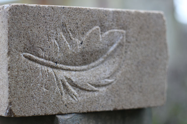 As light a feather carving in stone of