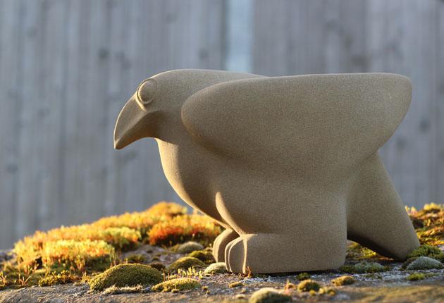 Ground Bird stone sculpture in the garden