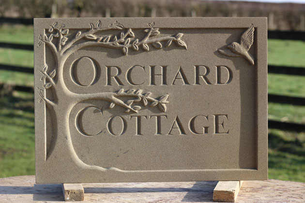 Letter cutting in stone - house sign
