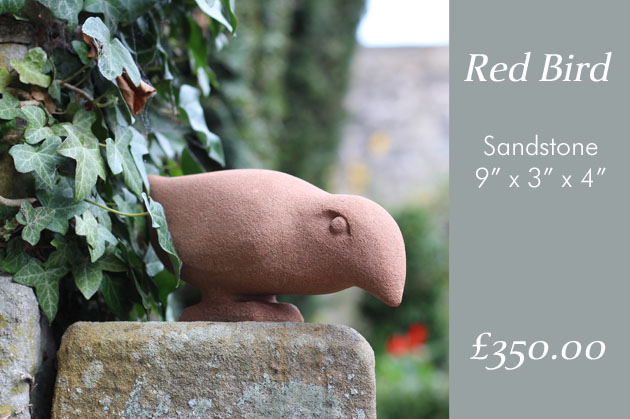 Red Bird stone sculpture in the garden