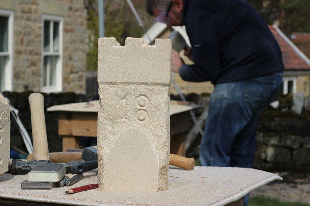 Castle carved in stone during the Spring Stone Carving Course