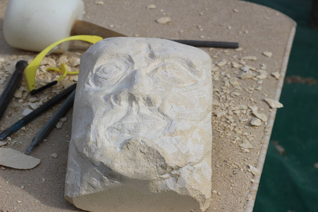 Face carved during the stone carving course