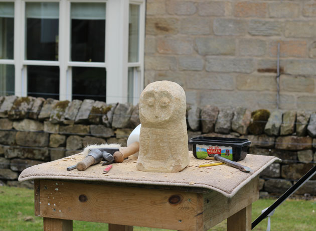 Owl waiting for his feet to be carved