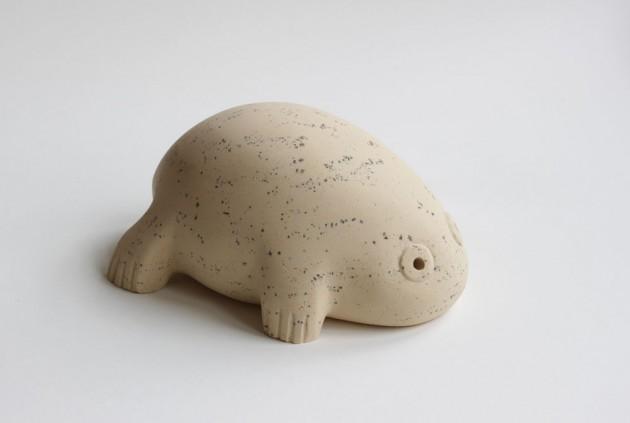 Froglet sculpture carved in stone