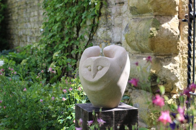 Owl Fly stone sculpture