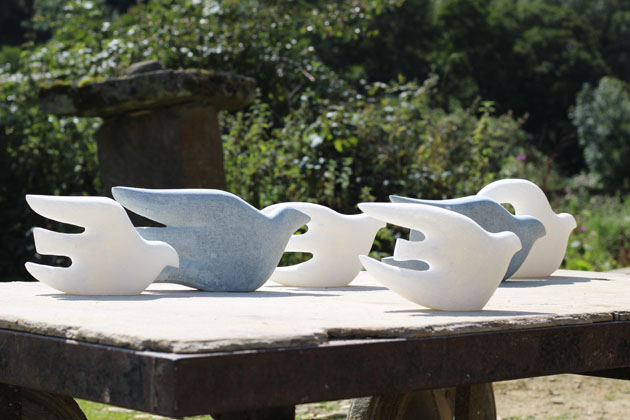 Flock of stone birds sculpture