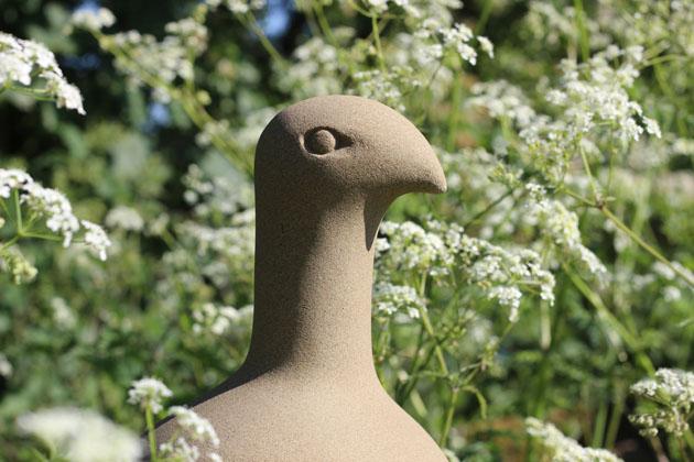 Lookout Bird stone sculpture