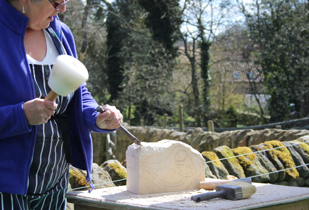 Carving begins on the stone carving course