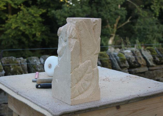 carved stone foliage