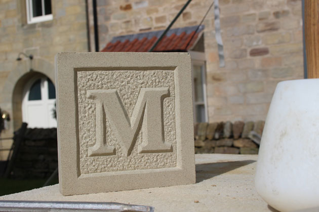 relief carved letter