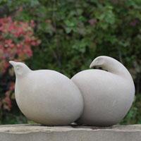Side by side bird sculpture