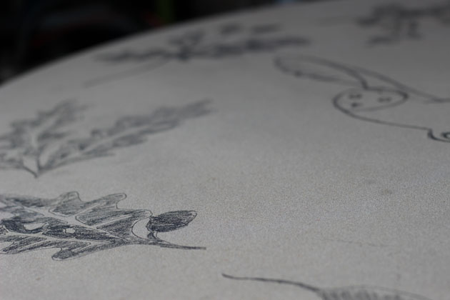 design sketched on stone before carving