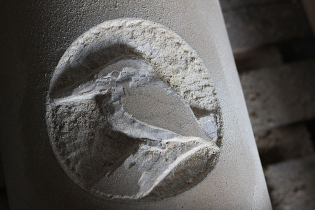 Carving a Kingfisher in stone
