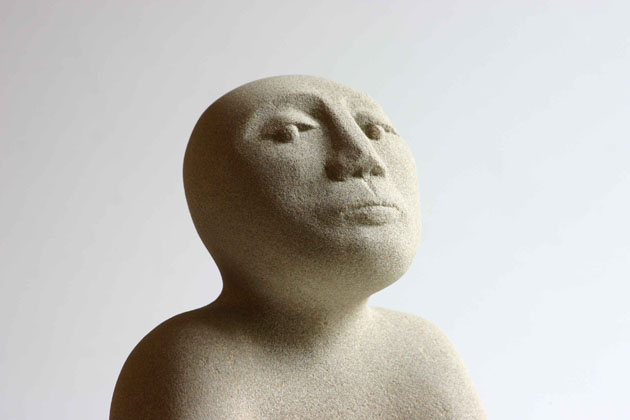 Man - sculpture of a head carved in sandstone