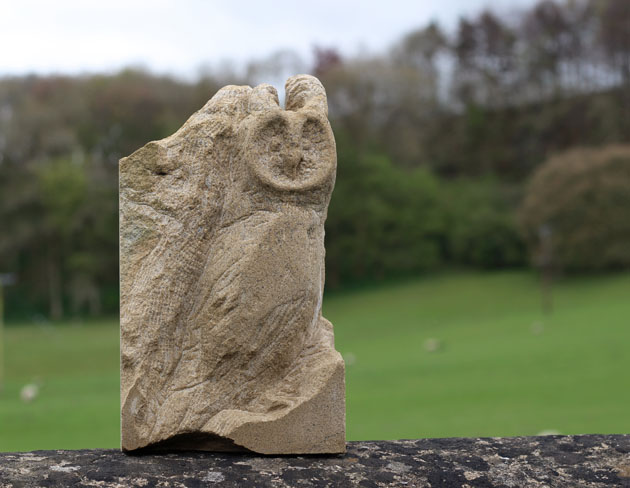 Long eared owl stone carving