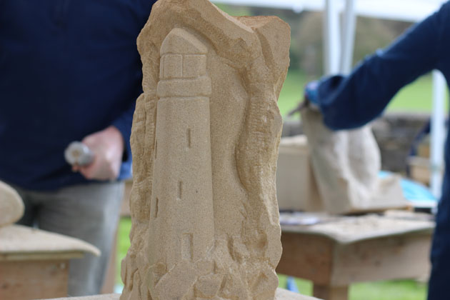 Stone carving of a lighthouse