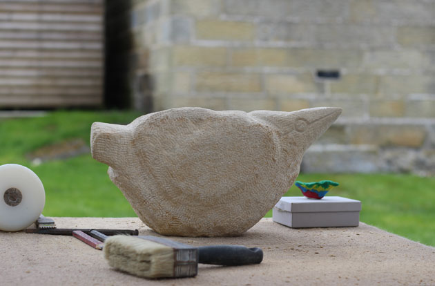 Bird carved in stone