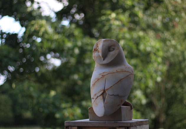 Barn Owl stone sculpture