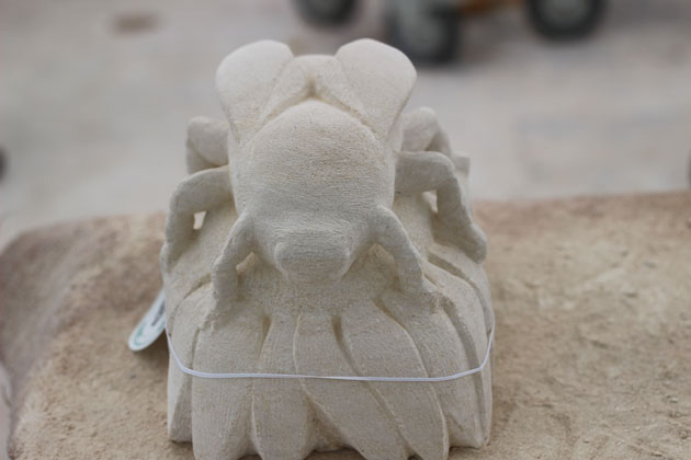 Bee on a flower stone carving
