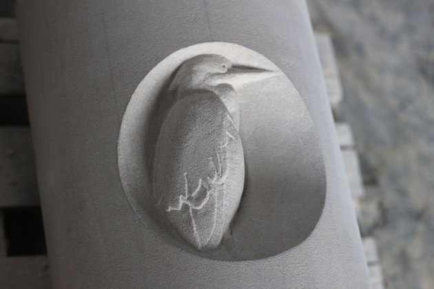 Heron carved in stone
