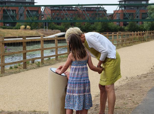 Walkers read the plaque