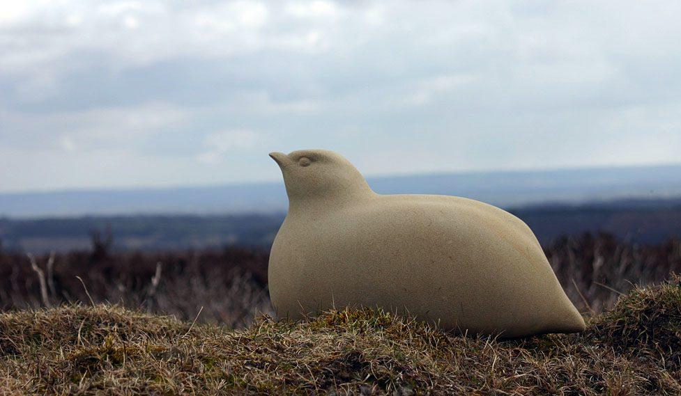 Partridge sculpture in stone