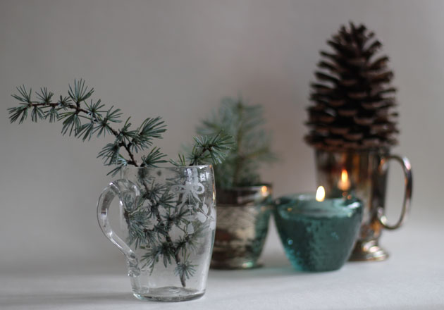 Christmas morning candles and fir cones