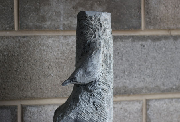 Carving progress nuthatch sculpture in stone