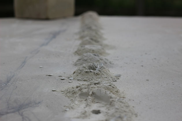 Line of drill holes in stone