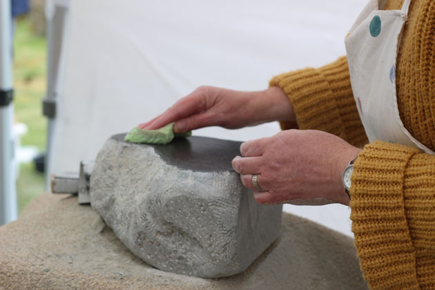 polishing the stone surface
