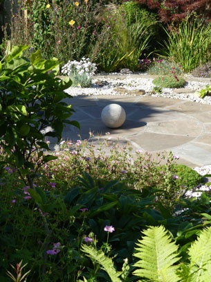 Ferns unfurling sculpture in the garden