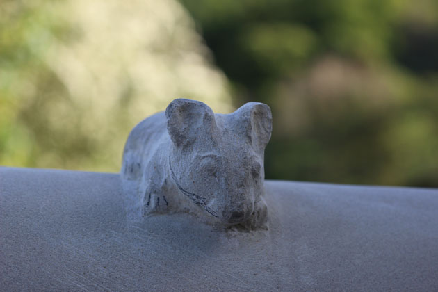 stone carving of a mouse