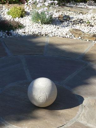 Ferns unfurling stone sculpture